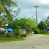 The few remaining houses in Madrich, where Outer Island families live when they need to be on Yap.  Typhoon Sudal destroyed most of the houses in the enclave, and only two families live here now.
