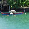 Canoe moored in Chamorro Bay