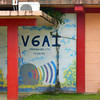 Colorful sign at the entrance to the new radio station building on Yap